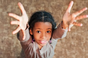 Girl with arms raised - get involved with human trafficking to save a life